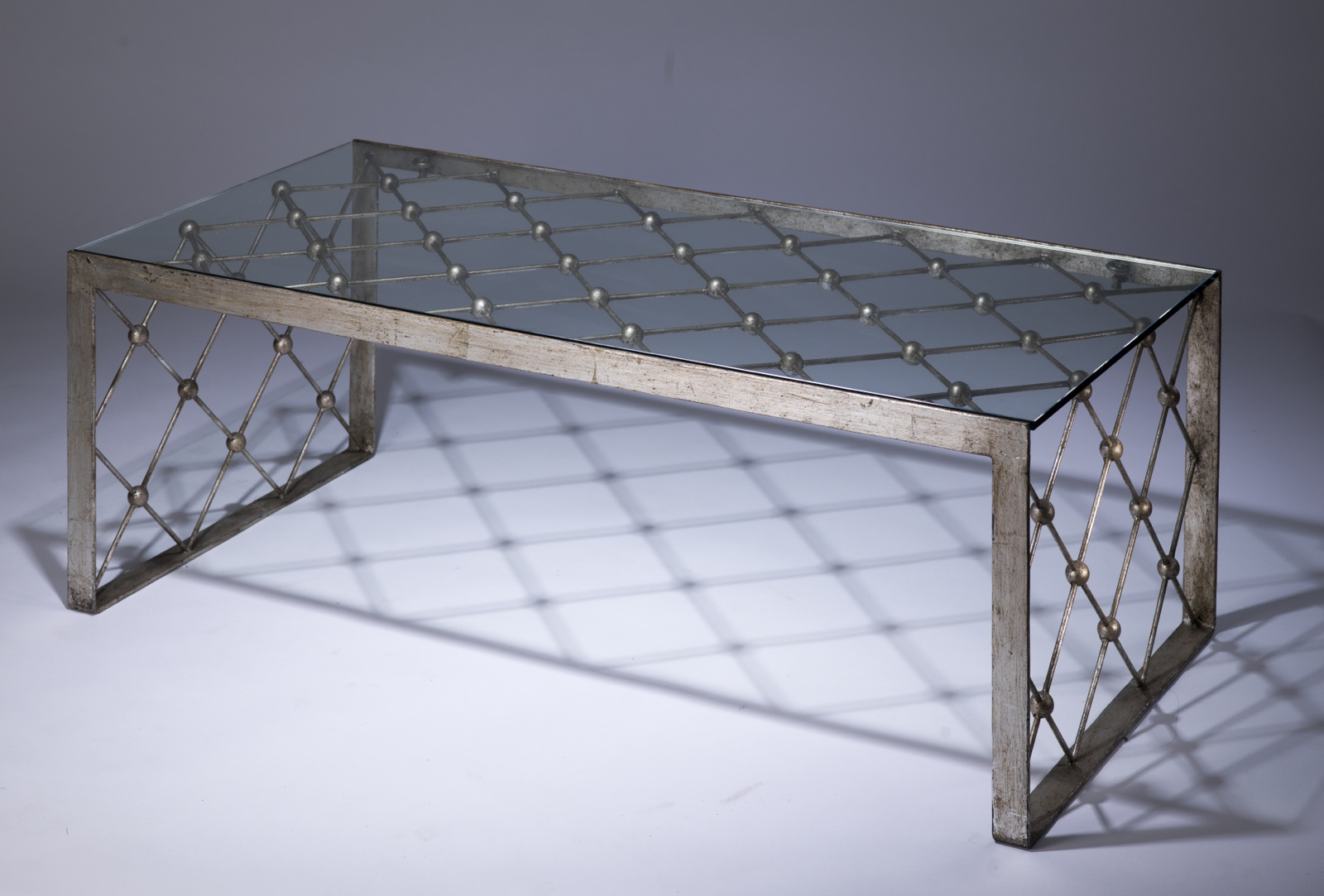 Wrought iron net coffee table in distressed silver leaf finish