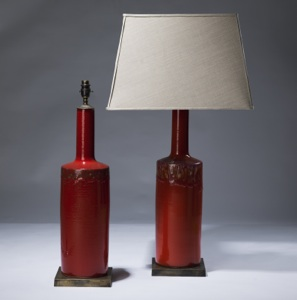 pair of medium red ceramic lamps on distressed brass bases (T3075)