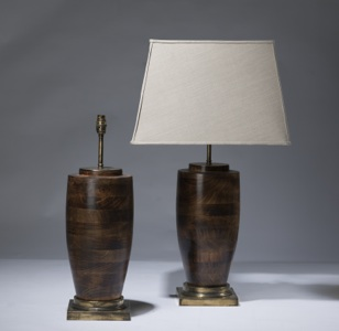 pair of medium dark brown wooden lamps on distressed brass bases (T3109)