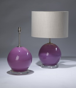 pair of medium pink glass lamps on perspex bases (T3134)