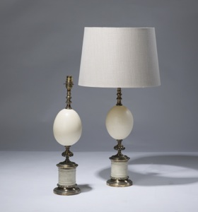 pair of medium cream ostrich egg lamps on distressed brass bases (T3156)