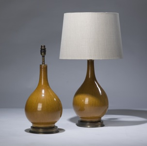 pair of small orange ceramic lamps on distressed brass bases (T3167)