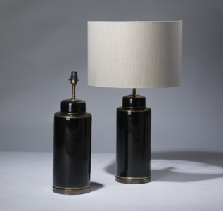 pair of medium black ceramic pot lamps with gold detail on distressed brass bases (T3191)