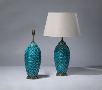 pair of medium blue 'fishscale' lamps on distressed brass bases (T3234)