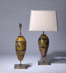 pair of medium yellow glass 'elliot' lamps on distressed brass bases (T3271)