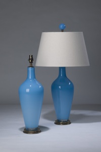 pair of medium sky blue 'standard' glass lamps on distressed brass bases & matching finials (T3288)