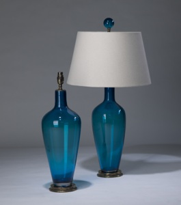 pair of medium transparent blue 'standard' glass lamps on distressed brass bases & matching finials (T3290)