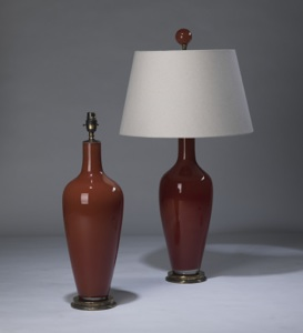 pair of medium dark orange brown 'standard' glass lamps on distressed brass bases & matching finials (T3302)