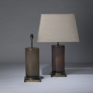 pair of medium dark apricot orange pink  'glass column' lamps on distressed brass bases (T3308)