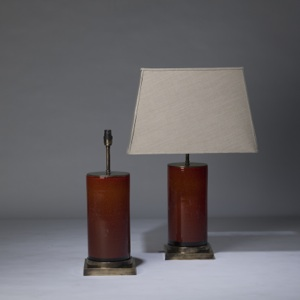 pair of medium dark orange red 'glass column' lamps on distressed brass bases (T3313)
