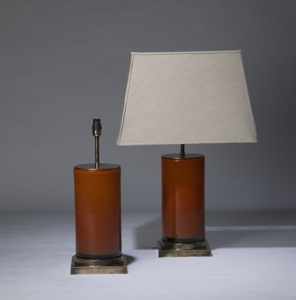 pair of medium orange 'glass column' lamps on distressed brass bases (T3315)