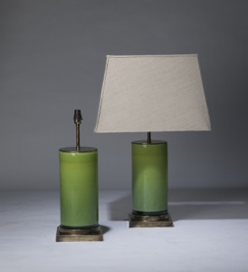 pair of medium lime green 'glass column' lamps on distressed brass bases (T3318)