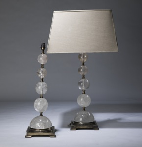 pair of large clear rock crystal 'graduated ball' lamps on distressed brass bases (T3330)