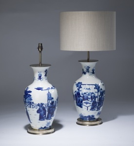 pair of medium blue & white ceramic lamps on distressed brass bases (T3484)