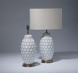 pair of medium black white honey comb ceramic lamps on distressed brass bases (T3511)