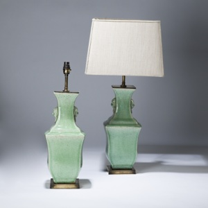 pair of medium pale green, celadon glazed ceramic lamps on distressed brass bases (T3606)