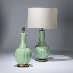 pair of medium pale green, celadon glazed ceramic lamps on distressed brass bases (T3607)