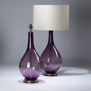 pair of large purple coloured teardrop shaped glass lamps on distressed brass bases (T3625)