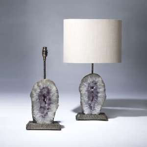 pair of small oval purple amethyst slices on textured distressed brass bases (T3680)