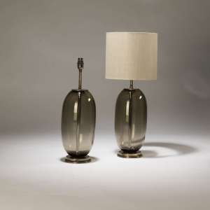 Pair of Smoke brown 'peanut' shaped glass lamps on distressed brass bases (T3702)