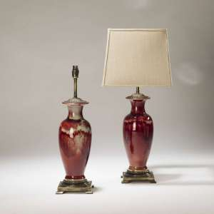 Pair of medium red faded ceramic lamps on distressed brass bases (T3707)