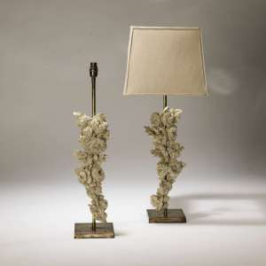 Pair of medium 18C white wooden floral pieces mounted on distressed brass bases (T3709)