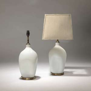 Pair of small opaque white glass lamps on distressed brass bases (T3722)