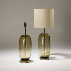 Pair of medium olive brown 'peanut' shaped glass lamps on distressed brass bases (T3724)