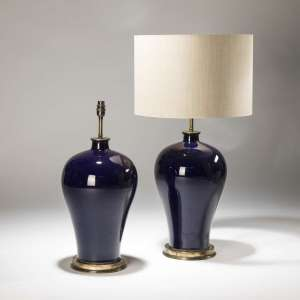 Pair of large navy ceramic lamps on distressed brass bases (T3741)