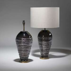Pair of grey, purple threaded glass lamps on distressed brass bases (T3777)