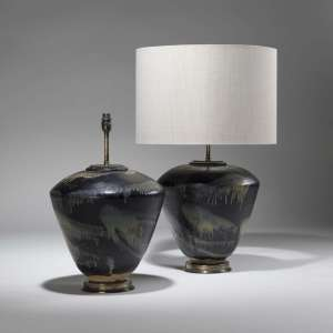 Pair of large black individually splashed glazed ceramic vases on distressed brass bases (T3791)
