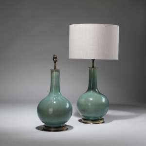 Pair of medium green glazed ceramic lamps on distressed brass bases (T3796)