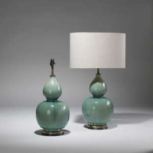 Pair of medium double gourd green glazed ceramic lamps on distressed brass bases (T3797)