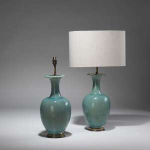 Pair of medium green glazed ceramic lamps on distressed brass bases (T3798)