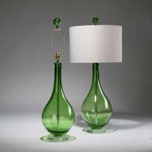 Pair of large emerald green glass teardrop lamps on perspex bases (T3803)