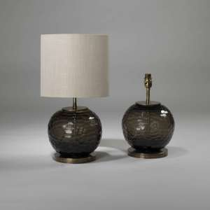 Pair of small smoke brown cut glass lamps on brass bases (T3894)