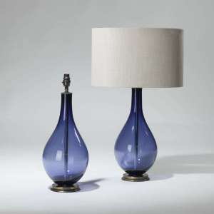 Pair of medium blue purple coloured teardrop shaped glass lamps on brass bases (T3945)