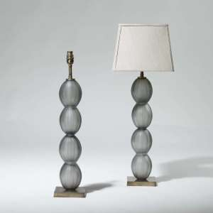 Pair of tall grey stacked glass balls on brass bases (T3951)