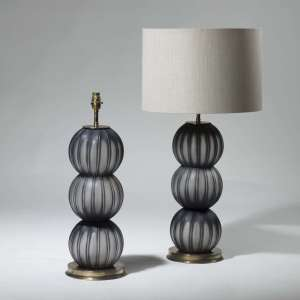 Pair of medium black stacked blown glass balls on round brass bases (T3963)