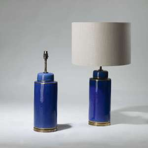 Pair of medium blue glazed cylinder lamps on brass bases (T3988)