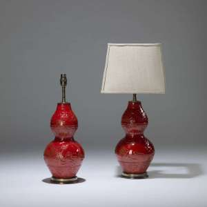 Pair of small red ceramic double gourd lamps on brass bases (T4014)