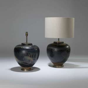 Pair of large black ceramic urn lamps with 'dribble glaze' on round brass bases (T4028)