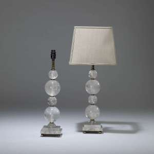Pair of small rock crystal stacked ball lamps on rock crystal square bases (T4034)