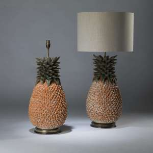Pair of large orange green ceramic pineapple lamps on round brass bases (T4087)