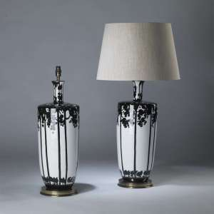 Pair of large black and white ceramic tree lamps on round brass bases (T4089)