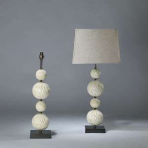 Pair of medium cream bone 4 ball stacked lamps on square brass bases (T4093)