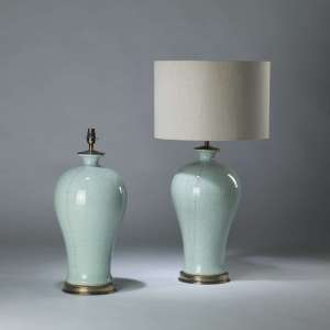 Pair of large celadon blue ceramic lamps on round brass bases (T4097)