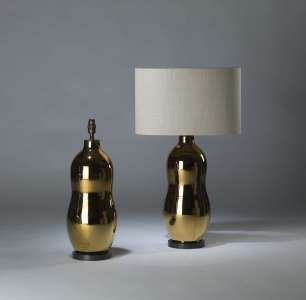 Pair of medium gold ceramic 'monkeynut' lamps on round brass bases (T4109)