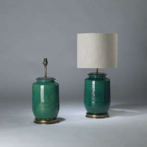 Pair of medium green ceramic 'bamboo' lamps on round brass bases (T4110)