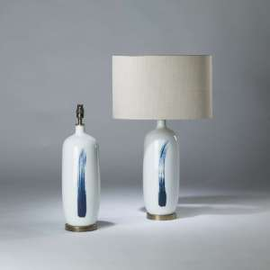 Pair of small white ceramic lamps with blue brush stroke on round brass bases (T4121)
